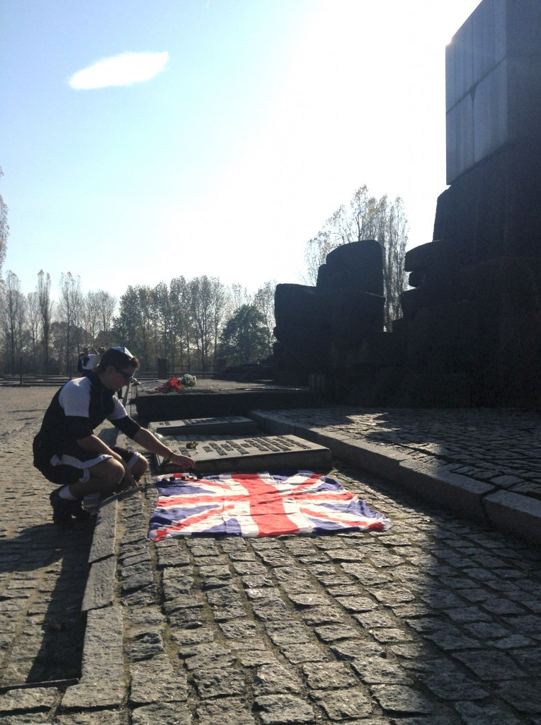 Laying the flag and tokens at the main memorial at Auschwitz-Birkenau