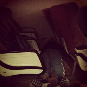Daniel asleep on the ferry with cushions on the floor - smart move!